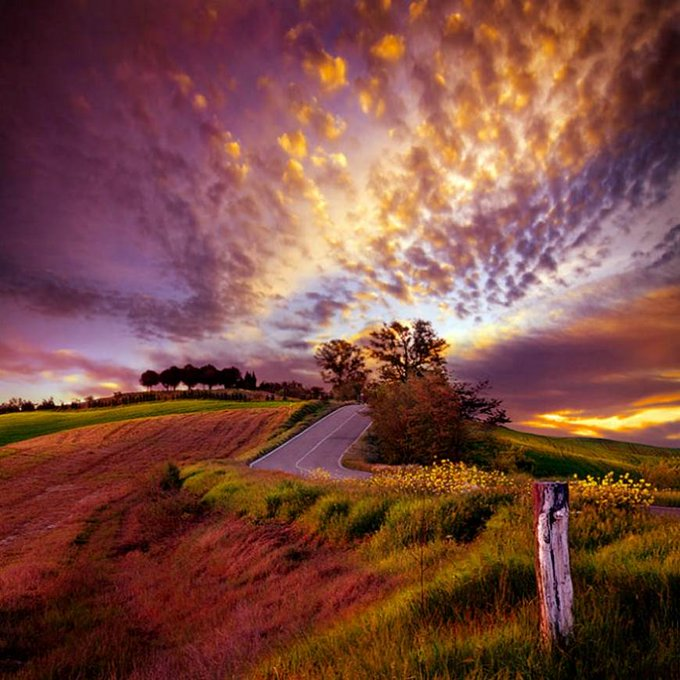 Country road and beautiful sky at sunset