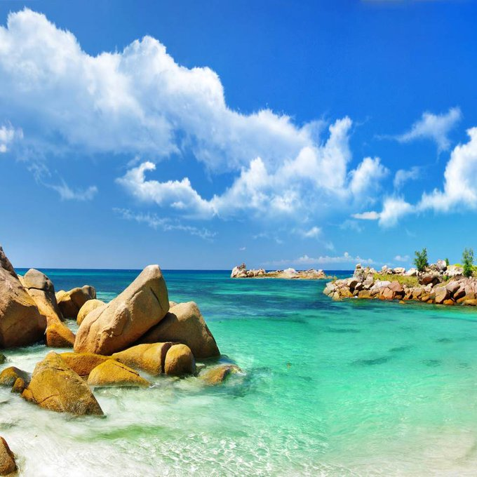 Tropical island with scenic turquoise sea water and clear blue sky