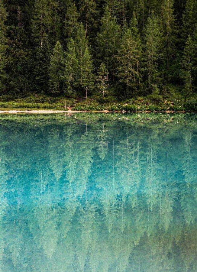 Glass-like reflections in Lago di Sorapis, Italy