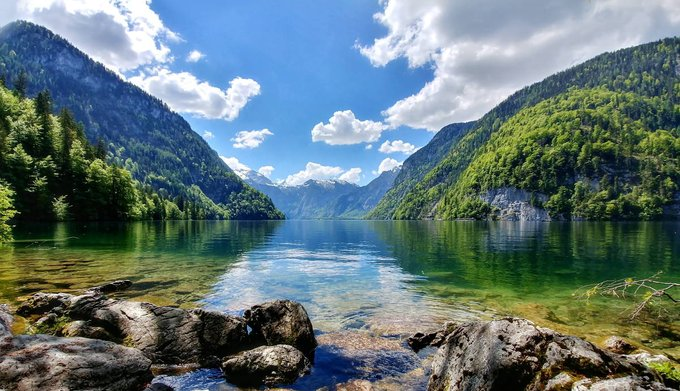 Stunning landscape of mountain lake on a sunny day with blue sky