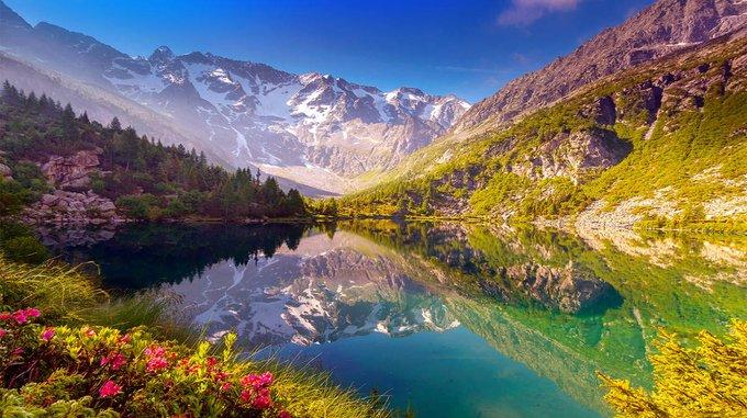 Beautiful mountain lake view and summer sunshine