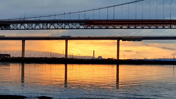 Sunset through the Forth Bridges from South Queensferry, Scotland