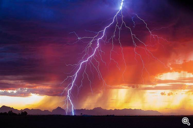Beautiful veiny sunset lightning bolt strikes near Salome