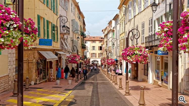 Flowered street of Antibes old town in Provence France