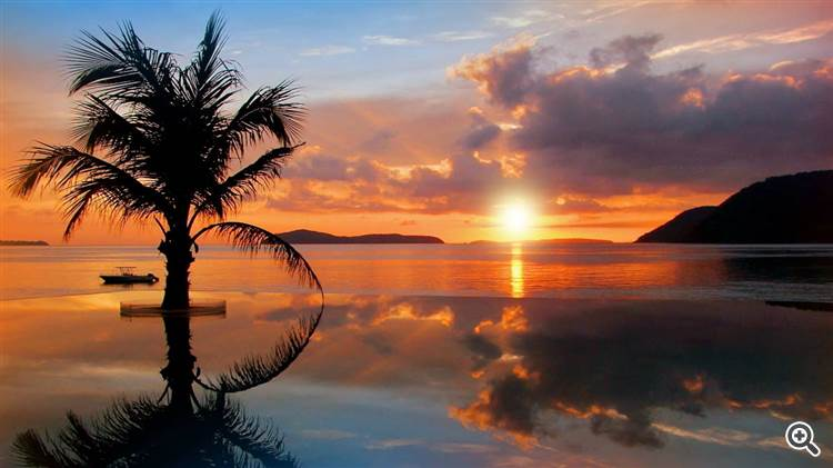 Tropical sunset and pool reflection in Phuket Thailand