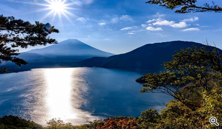Sunrise over a mountain lake on a sunny bright day