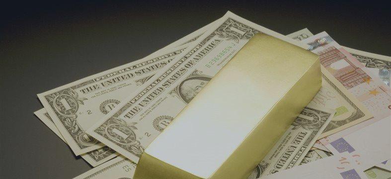 黄金价格新年飙涨9% 货币战成市场推手