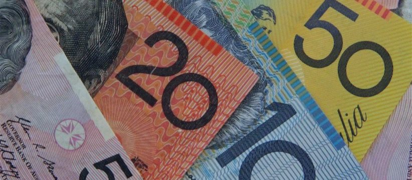 NZ dollar edges higher, Aussie lower vs greenback