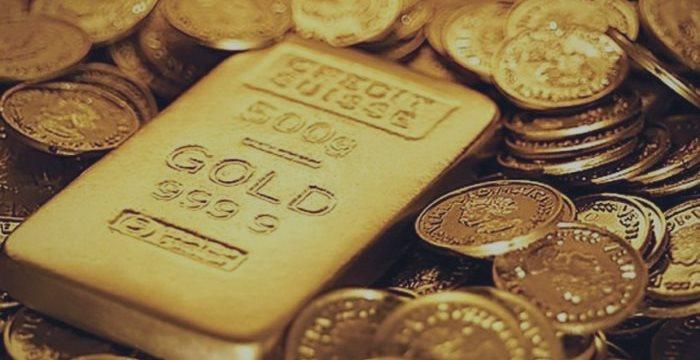 Золото в среду держится выше $1206 за унцию на слабом долларе