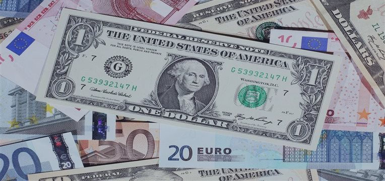 Dollar reaches one-week high vs euro after Fed officials' comments