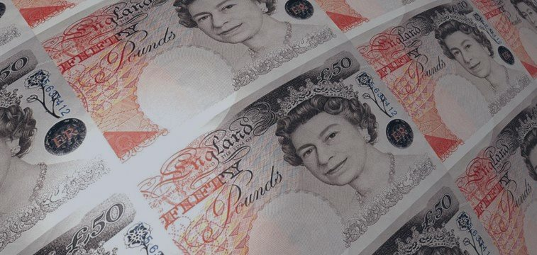 Pound touches one-week low versus dollar after disapponting UK data