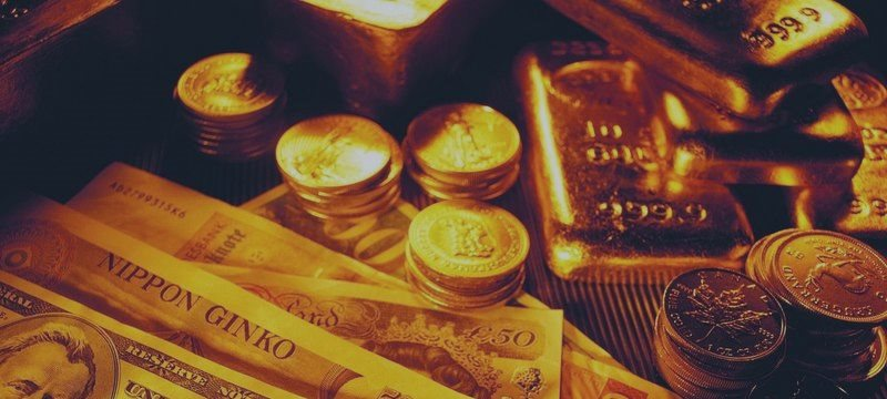 Gold hits two-week highs after Fed stands pat