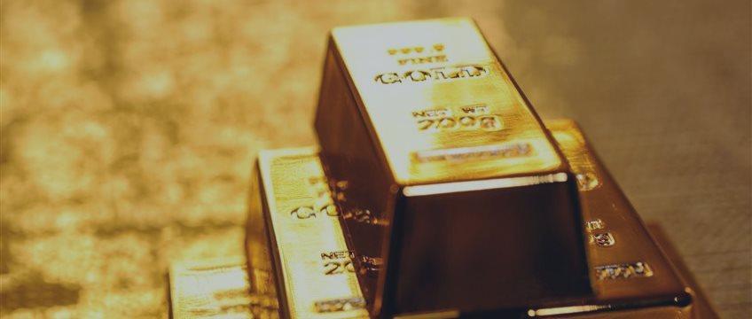 Золото окрепло на сомнениях относительно роста ставки ФРС