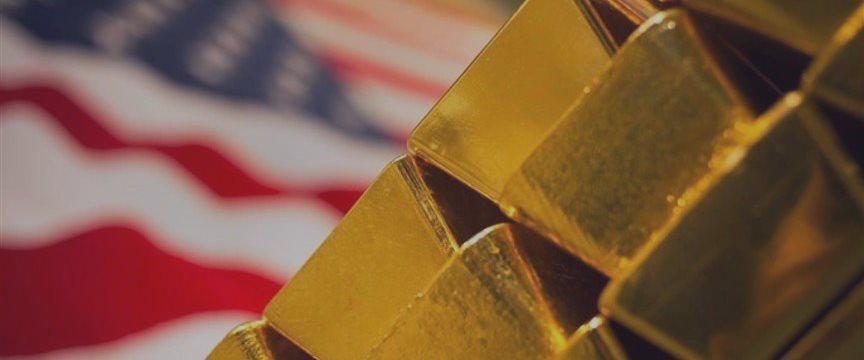 Золото борется со слабостью на перспективе роста ставок ФРС