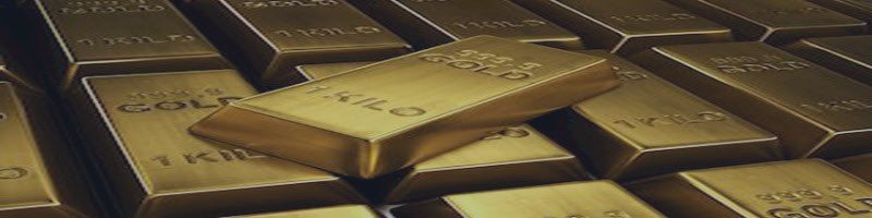 Gold Turns Negative after US Dollar Trim Losses on Stronger ISM Data