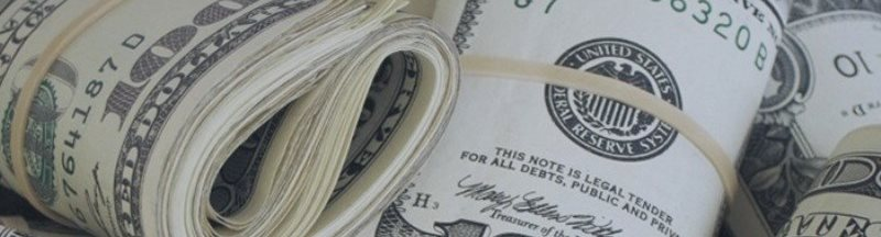 Доллар пытается отыграть потери против основных валют